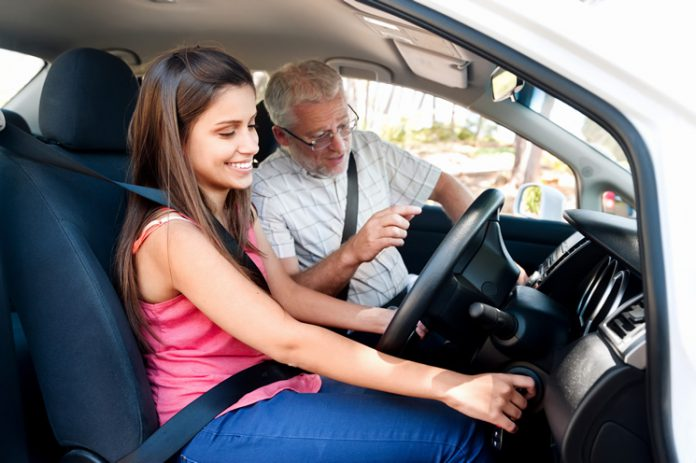 Learner Driver With Driving Instructor
