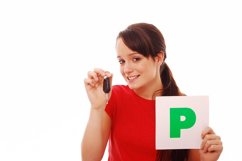 Learner driver holding her P Plate & Keys
