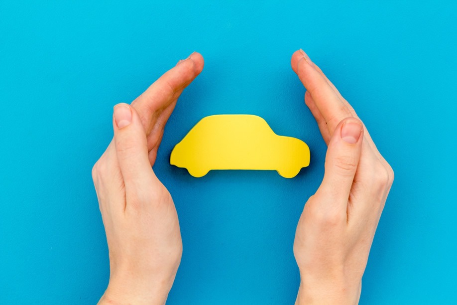 car cut out in the palm of your hand