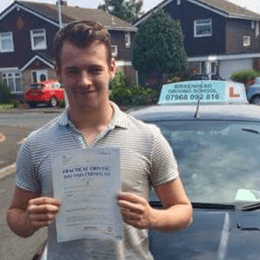 Young Male Learner Driver Holding a Driving Test Certificate