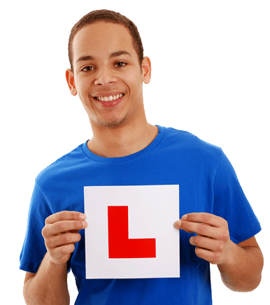 Young Male Learner Driver Holding an L Plate