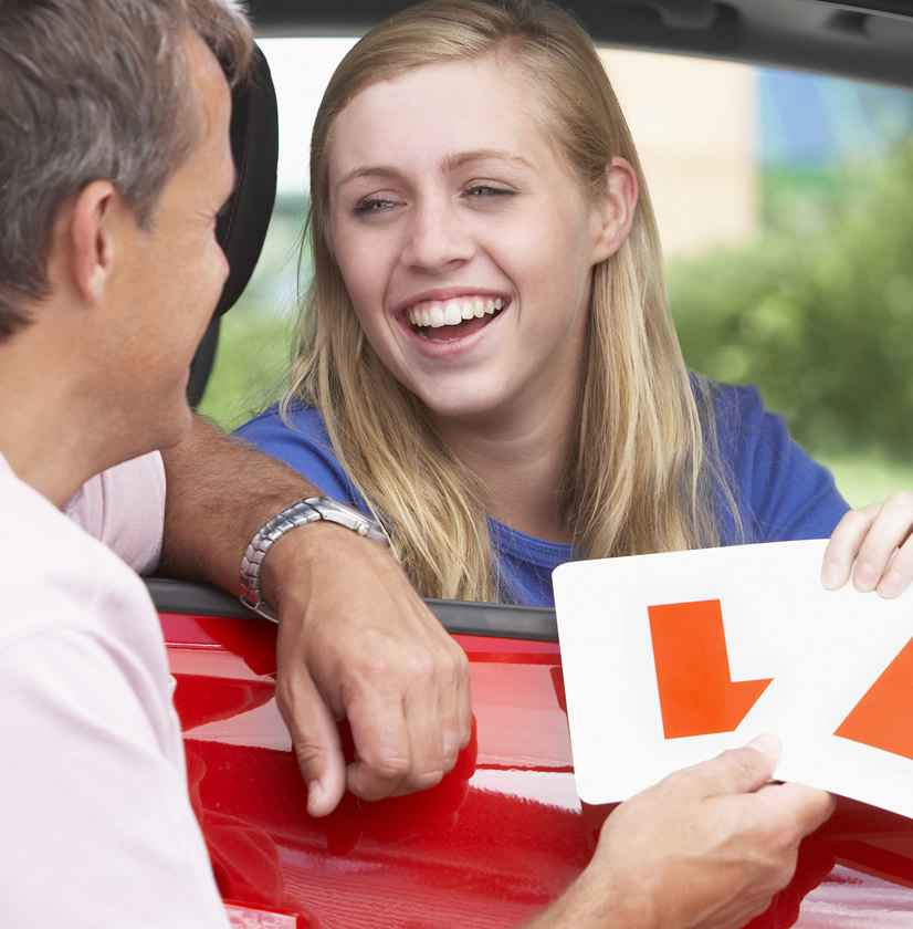 Young Learner Driver Being Handed L Plates