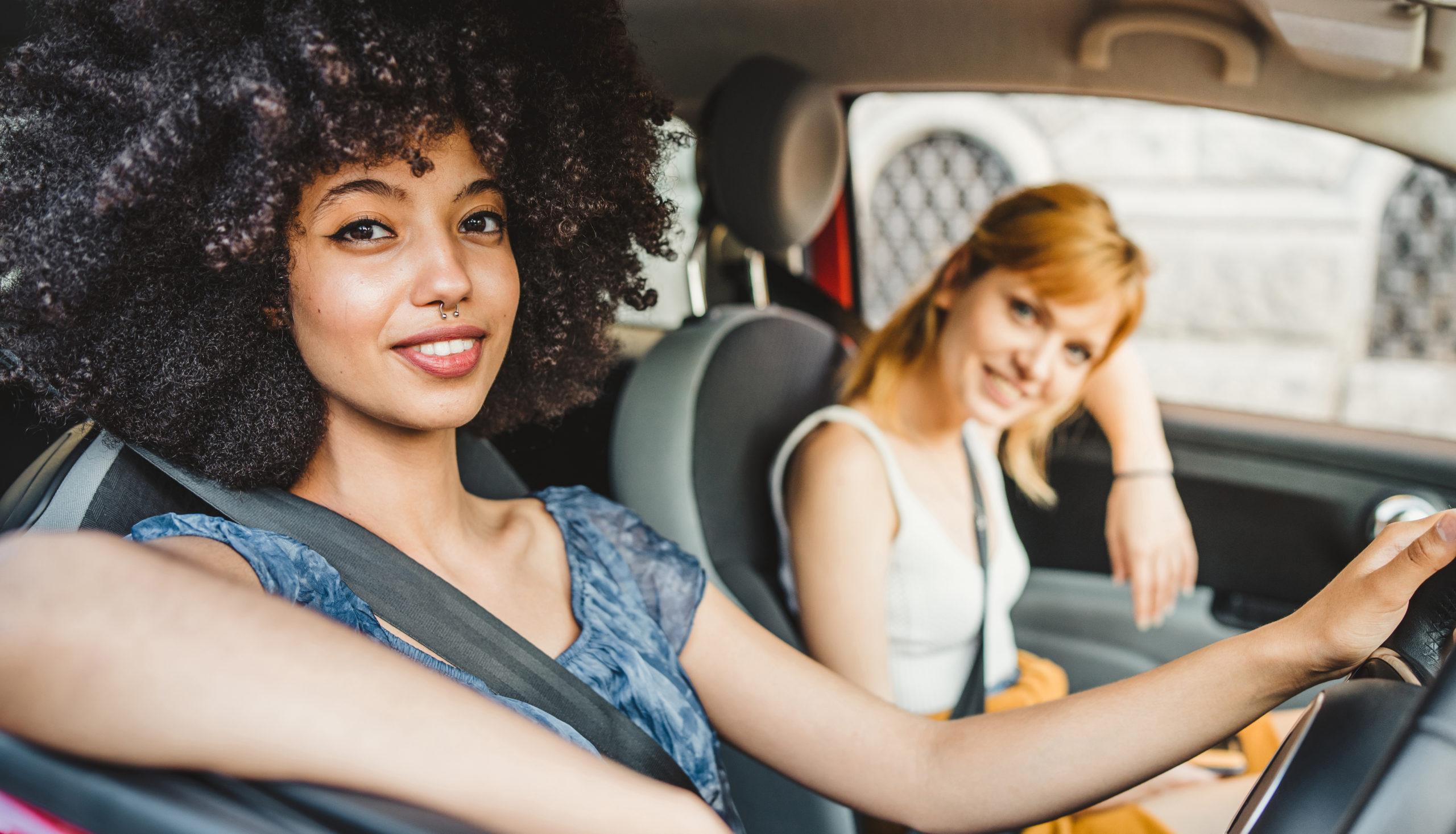 Learner Driver Smiling with Supervisor