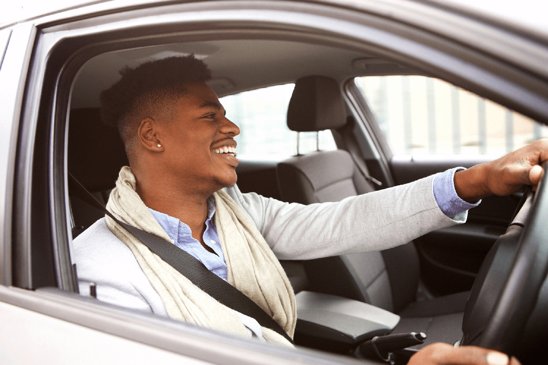 male learner driver smiling looking ahead